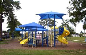 kids playground with shade sails covering the play area